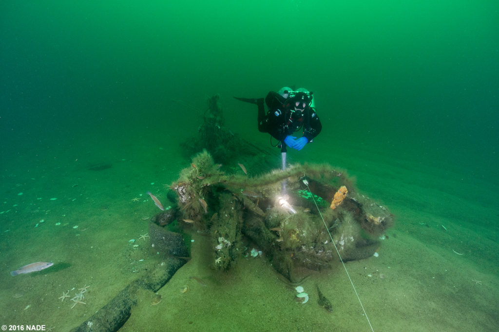 Scott hovering over the recently re-located stern piece of the North Star wreckage.